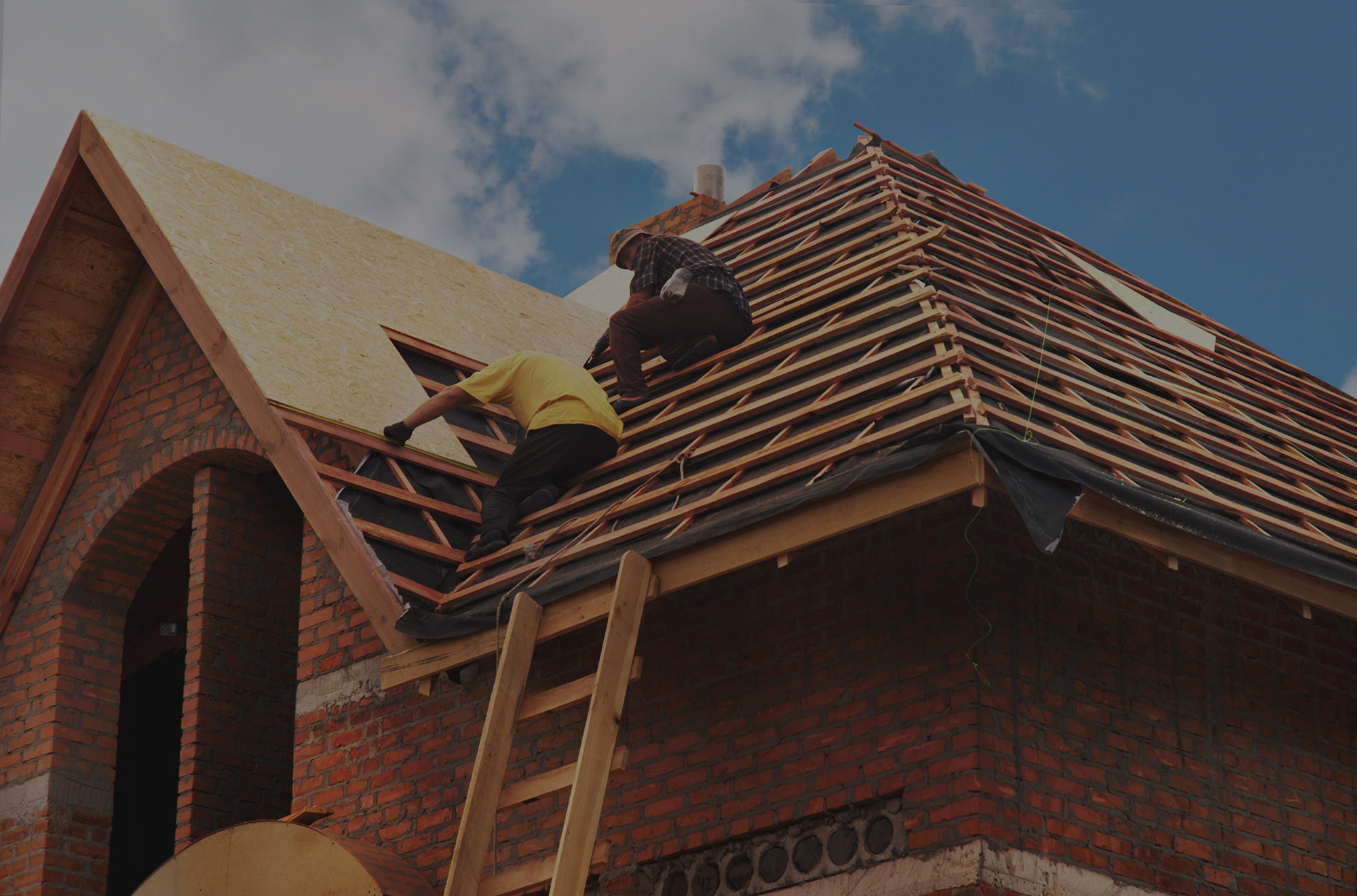 5ddef6d7e85f2a38f4fcd411_One Click Code Roof Workers Background